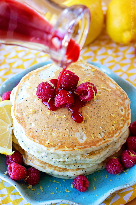 These light and fluffy lemon-poppy seed pancakes with raspberry syrup are perfect for spring and summer! They're packed full of flavor and topped with an irresistible homemade syrup.
