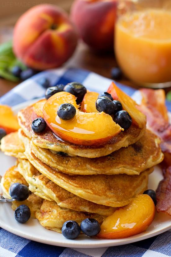 Blueberry Peach Cornmeal Pancakes | lifemadesimplebakes.com