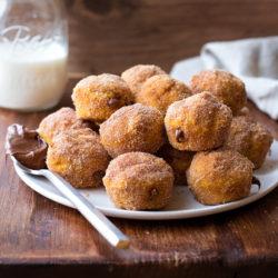 Nutella Stuffed Pumpkin Doughnut Holes | lifemadesimplebakes.com