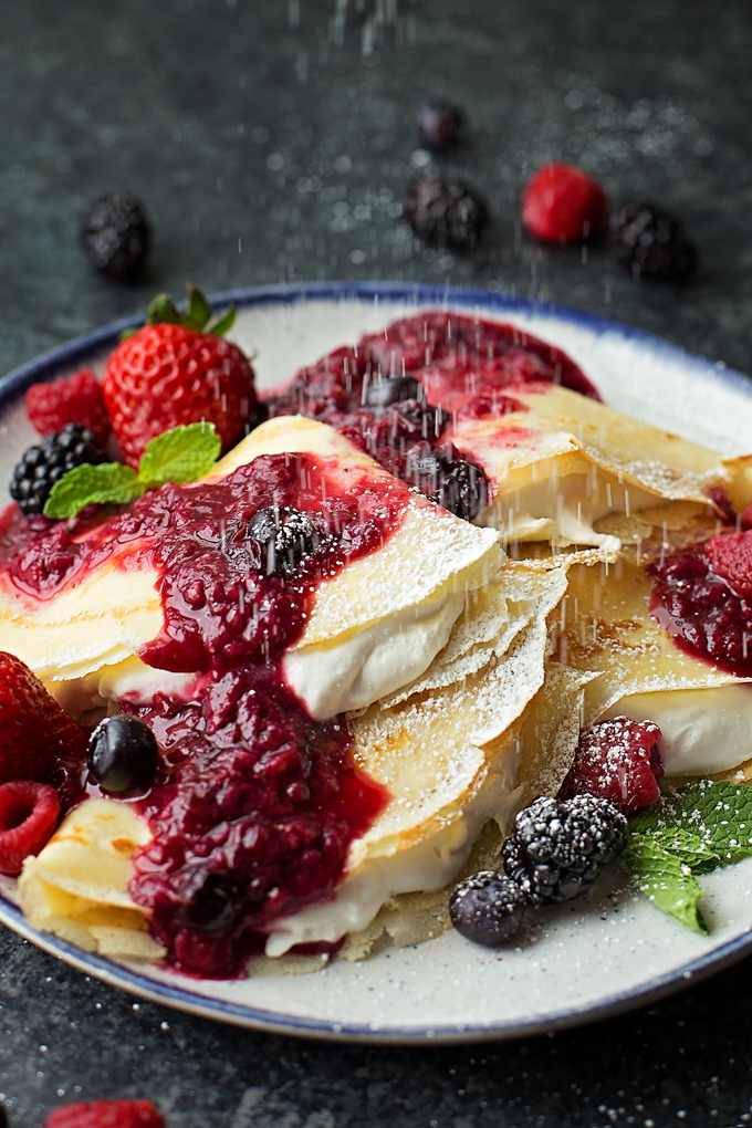 Berries & Cream Blender Crepes with powdered sugar.