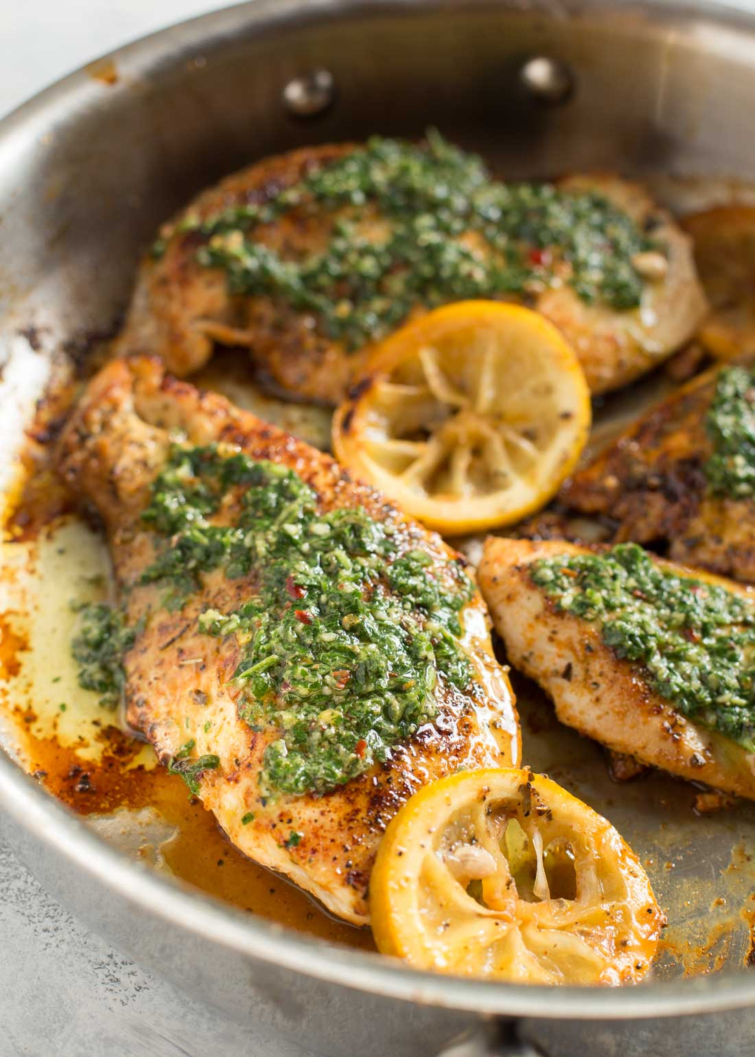 Chimichurri chicken with sauce in pan