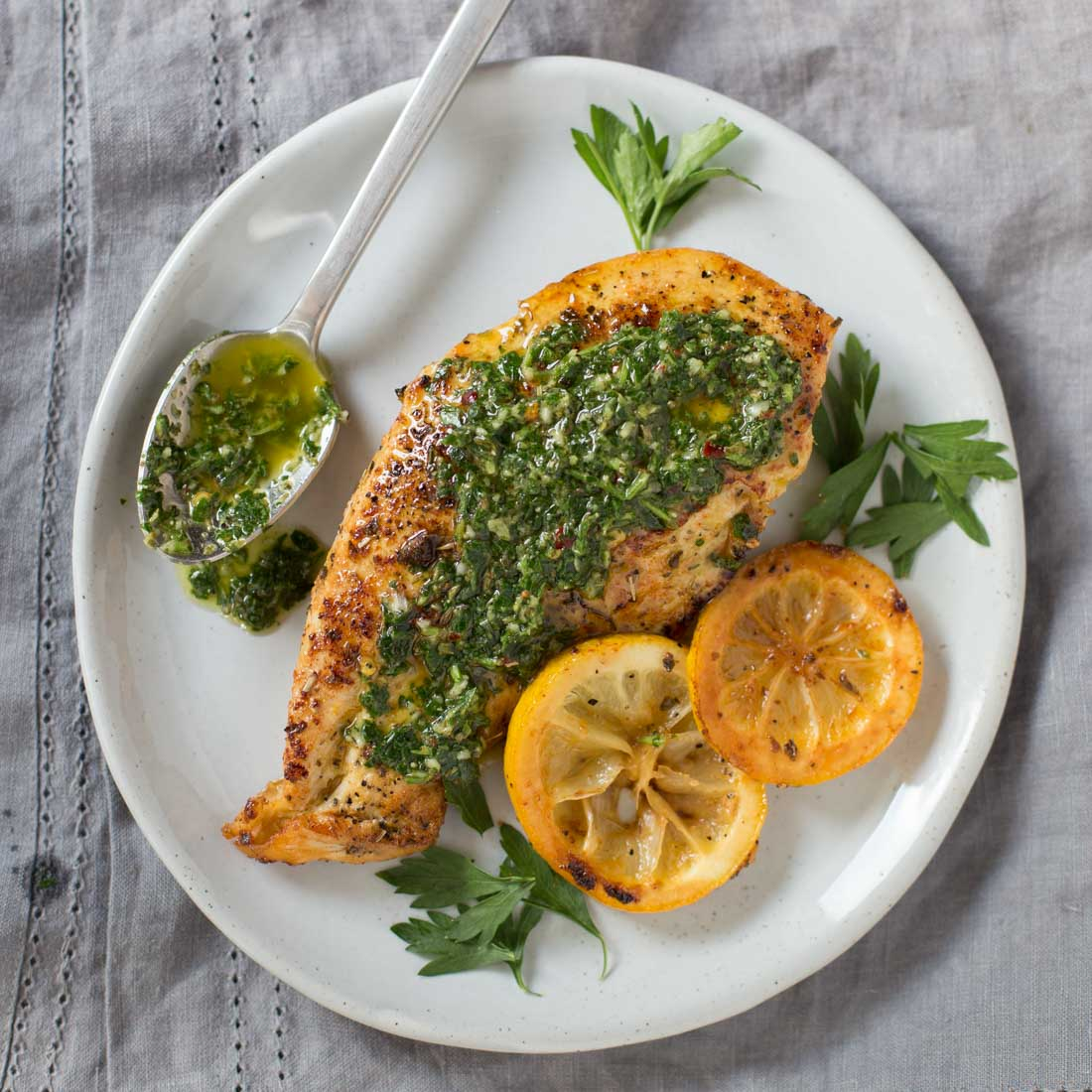 Chimichurri chicken with sauce on plate