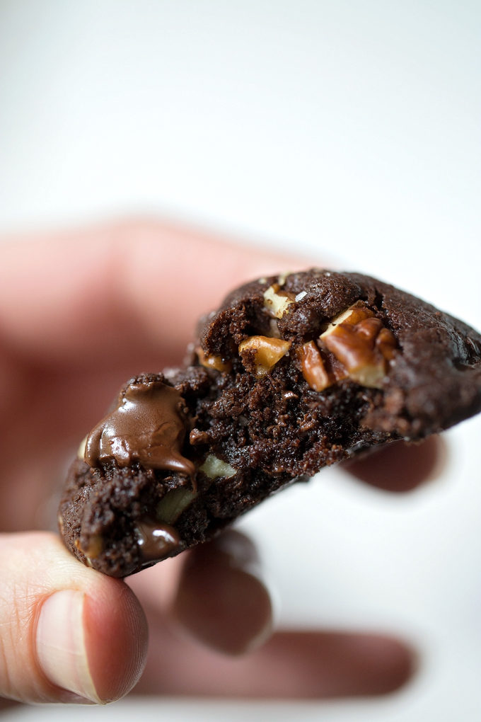 Gooey inside of a double chocolate coconut oil cookie made with chopped pecans.