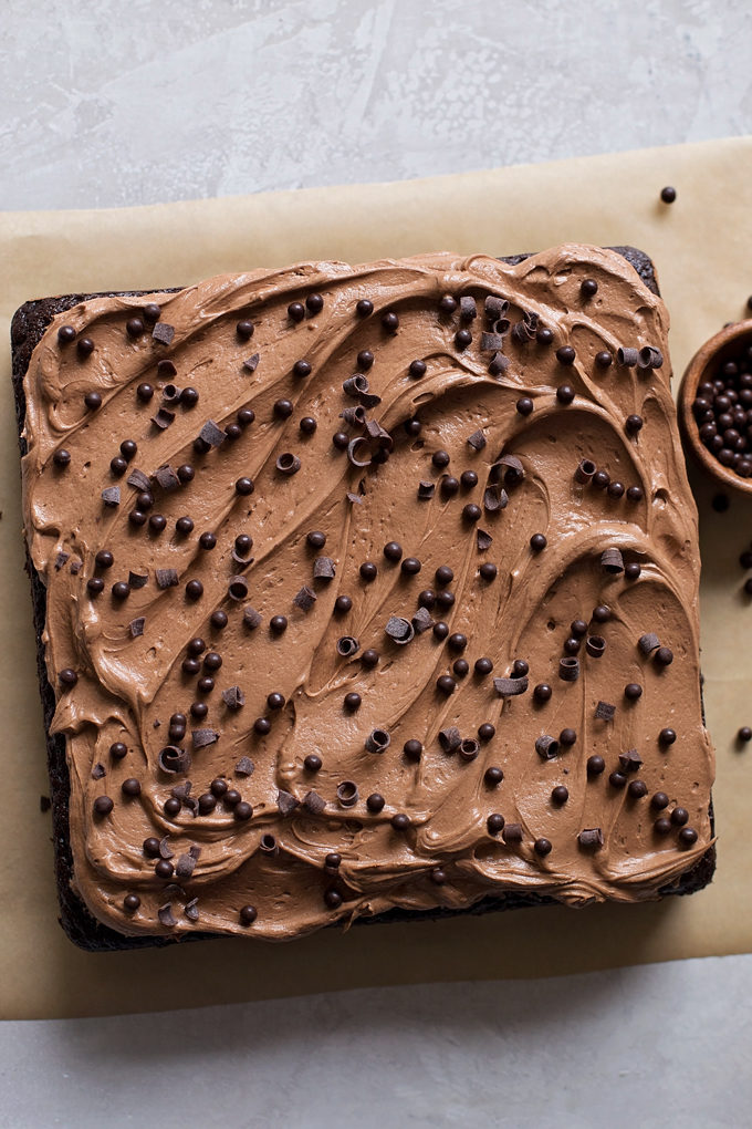 Baked and frosted everyday chocolate cake with cocoa buttercream. | lifemadesimplebakes.com