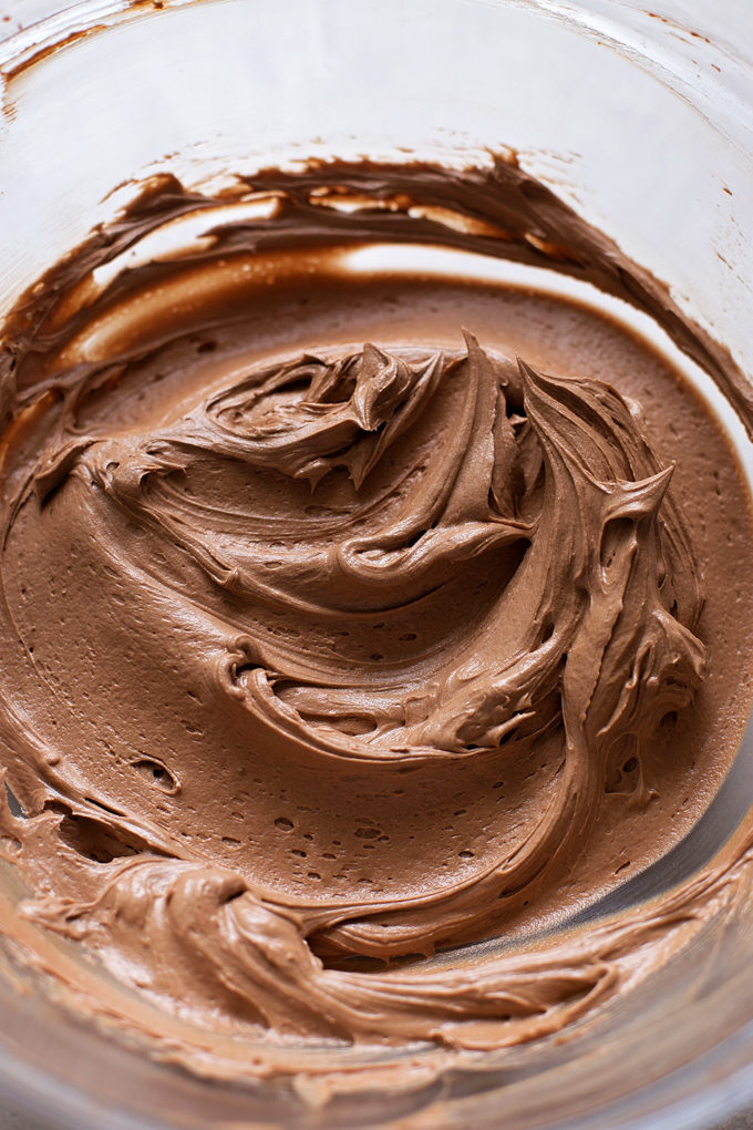 Light, sweet cocoa frosting to top the everyday chocolate cake. | lifemadesimplebakes.com