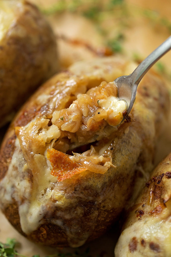 A fork full of french onion soup stuffed potatoes. | lifemadesimplebakes.com