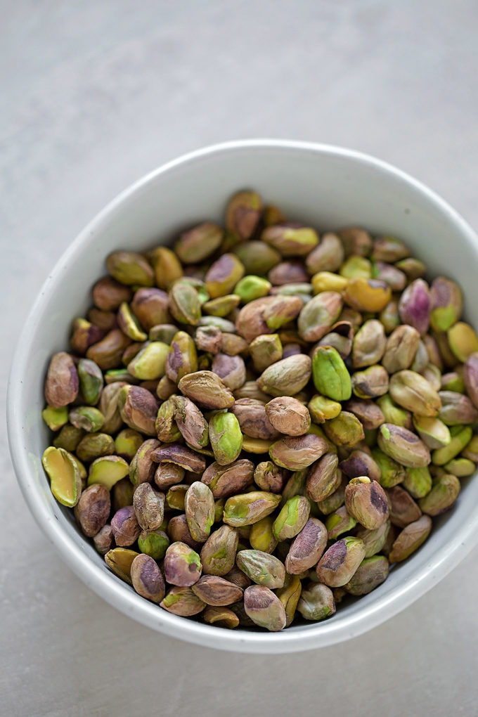 A bowl of shelled pistachios for the light and fluffy pistachio layer cake. | lifemadesimplebakes.com