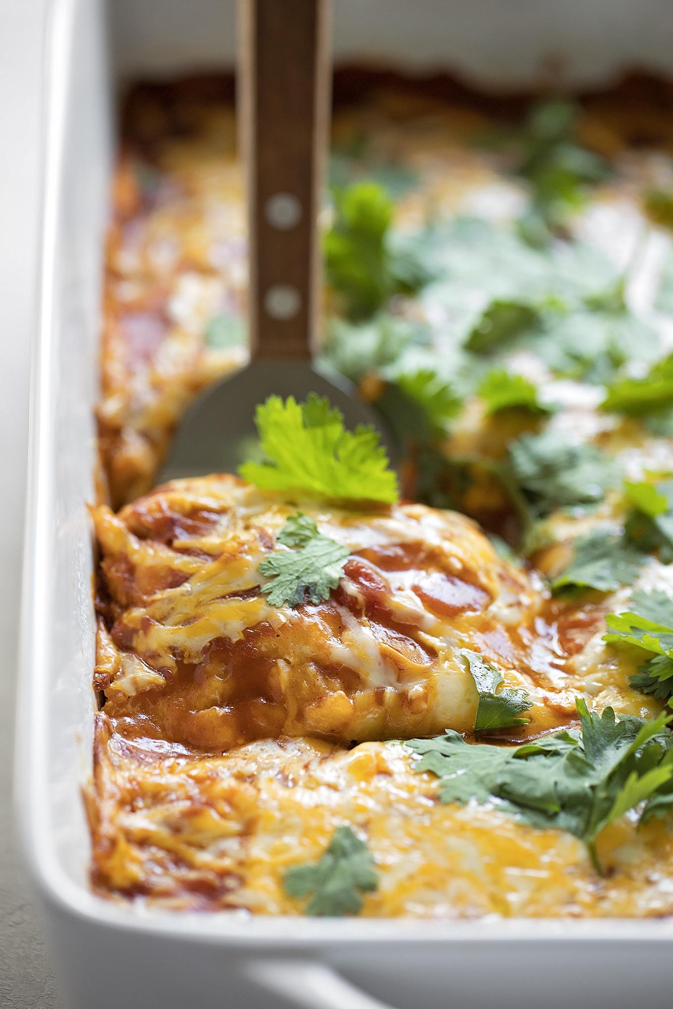 Scooping up a serving of pork tamale casserole.   lifemadesimplebakes.com