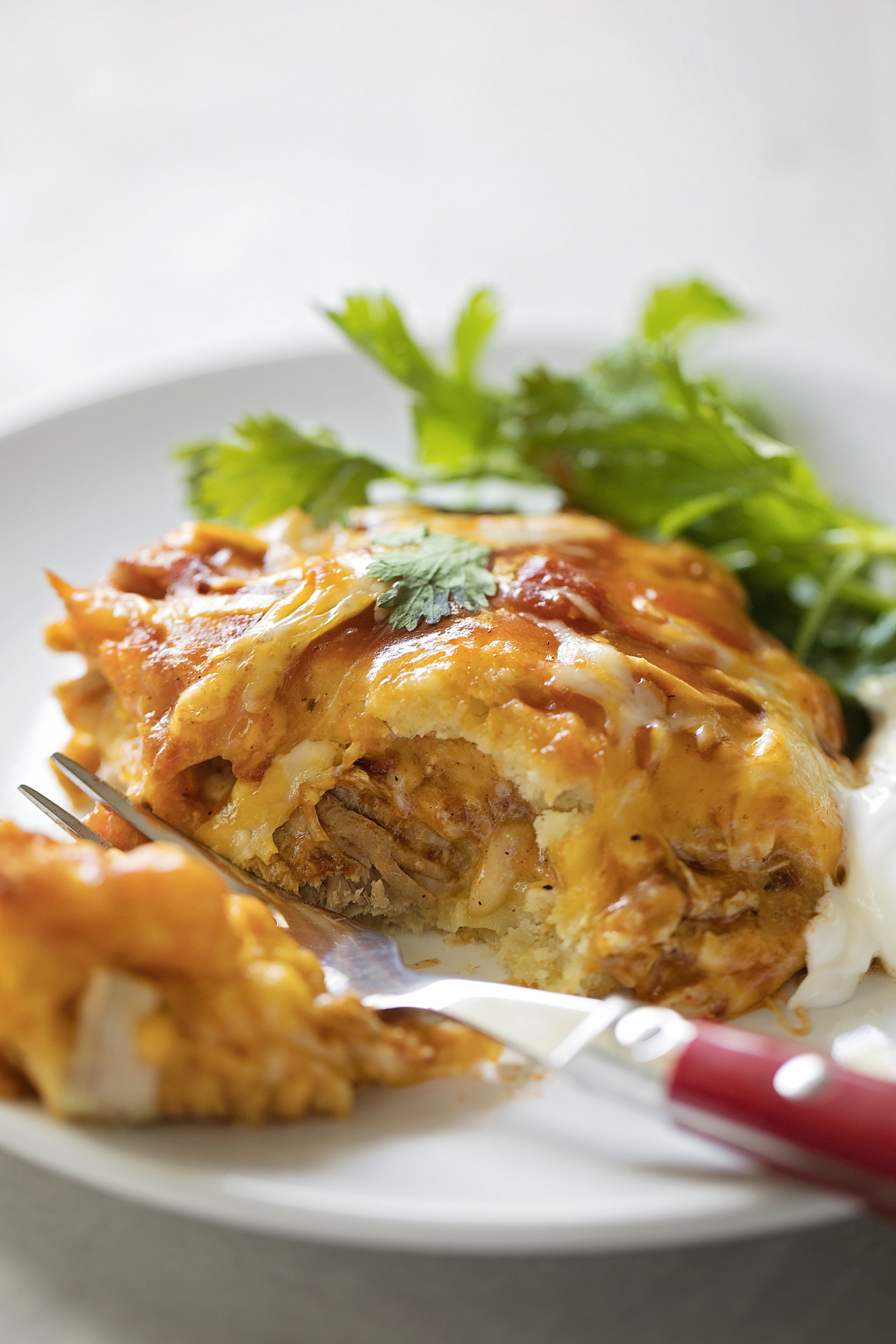 Pork tamale casserole with a bite taken out of it.   lifemadesimplebakes.com