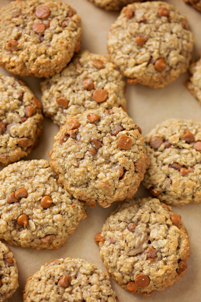 Apple cinnamon oatmeal cookies piled on top of each other. | lifemadesimplebakes.com