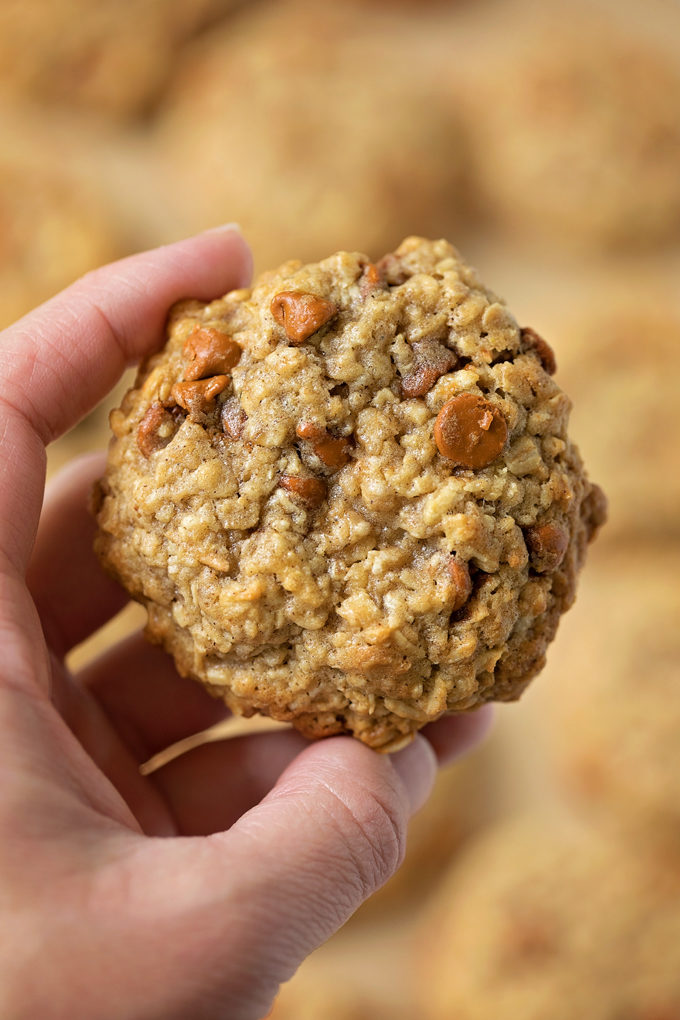 A freshly baked apple cinnamon oatmeal cookies with real apples in them. | lifemadesimplebakes.com