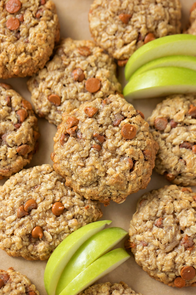 A pile of freshly baked apple cinnamon oatmeal cookies with apple slices. | lifemadesimplebakes.com
