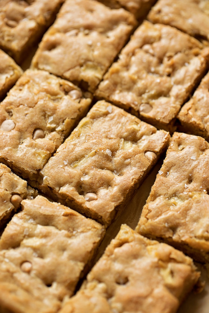 Spiced Caramel Apple Blondie bars cut into portions.