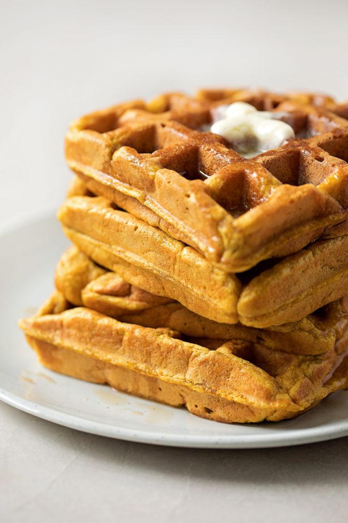 A tall stack of pumpkin spice waffles.