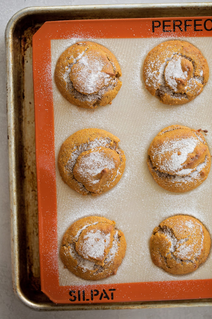 Baked whole wheat pumpkin muffins in a silicone mold. | lifemadesimplebakes.com
