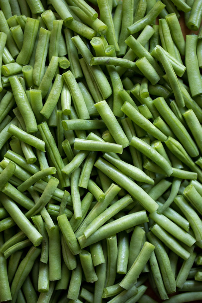 Fresh cut green beans ready to be used in creamy green bean casserole.