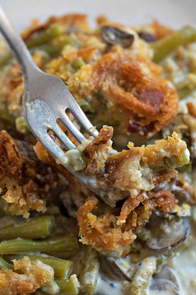 A fork full of creamy green bean casserole/