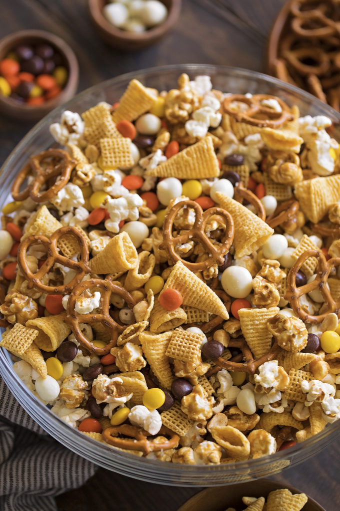 A bowl full of Thanksgiving snack mix. A fun and festive treat!