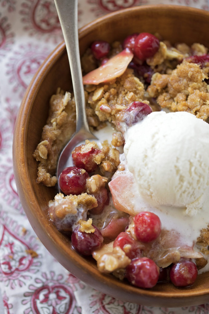A close up of a bowl of the best cranberry apple crisp.