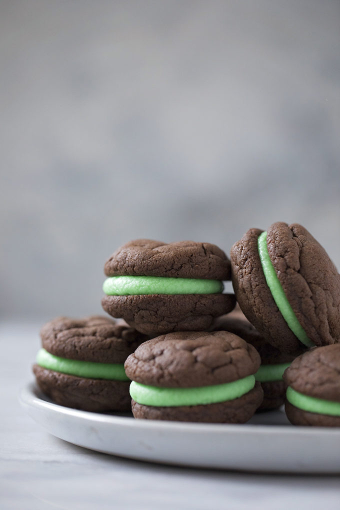 Chocolate mint sandwich cookies pile on a plate ready to be served.