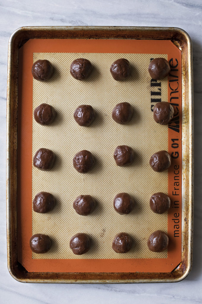 Balls of dough rolled and place on a silpat silicone baking mat.