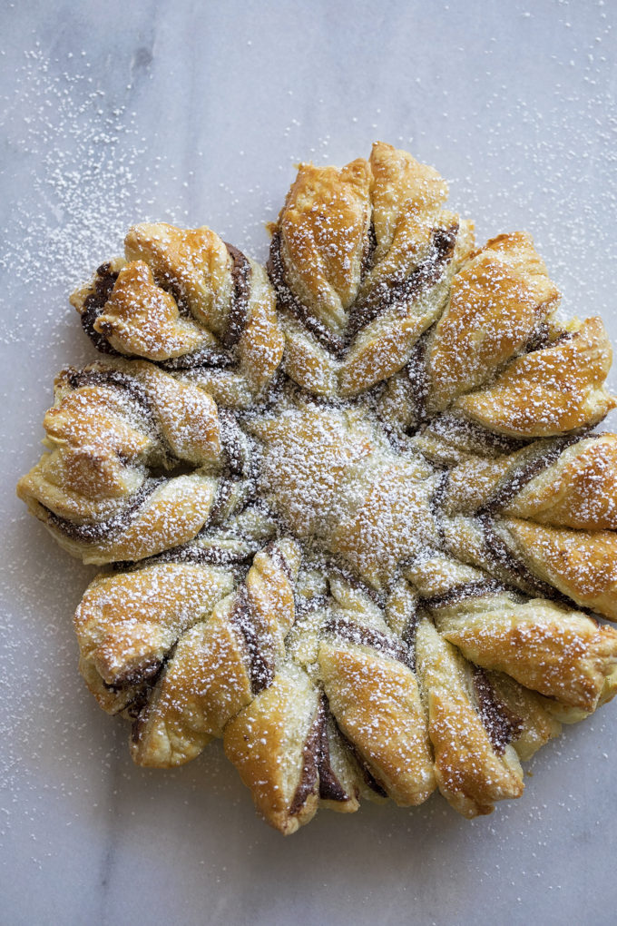 A beautiful and impressive Nutella puff pastry snowflake dusted with powdered sugar