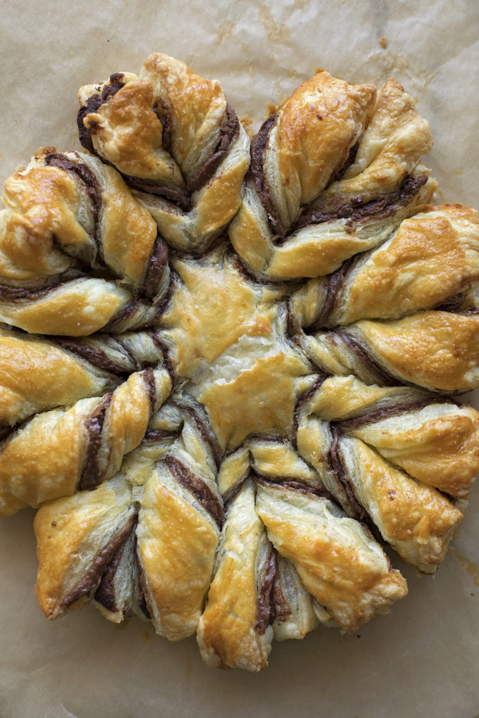 A freshly baked Nutella puffed pastry snowflake.