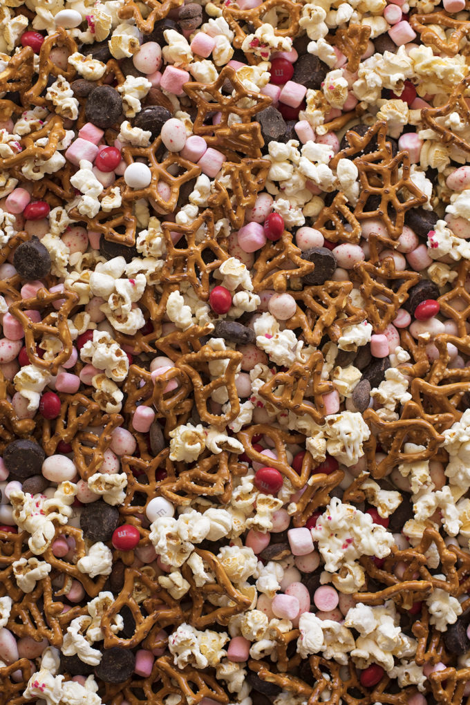 All of the ingredients for peppermint snack mix get tossed together, then it's ready to bag up or serve.
