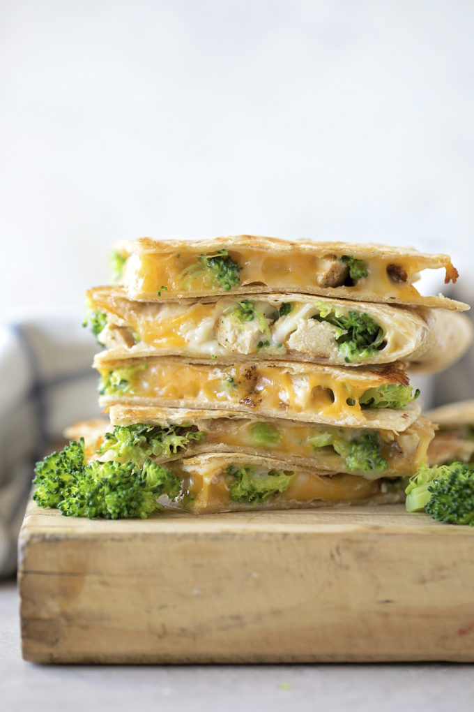 A tall stack of freshly grilled chicken broccoli quesadillas.