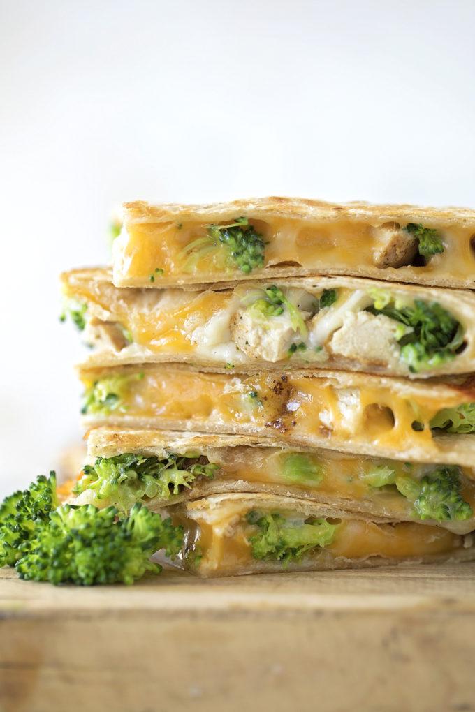 A stack of cheesy chicken broccoli quesadillas.