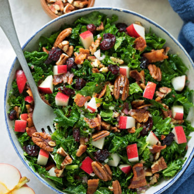 Healthy and easy cranberry apple pecan kale salad.