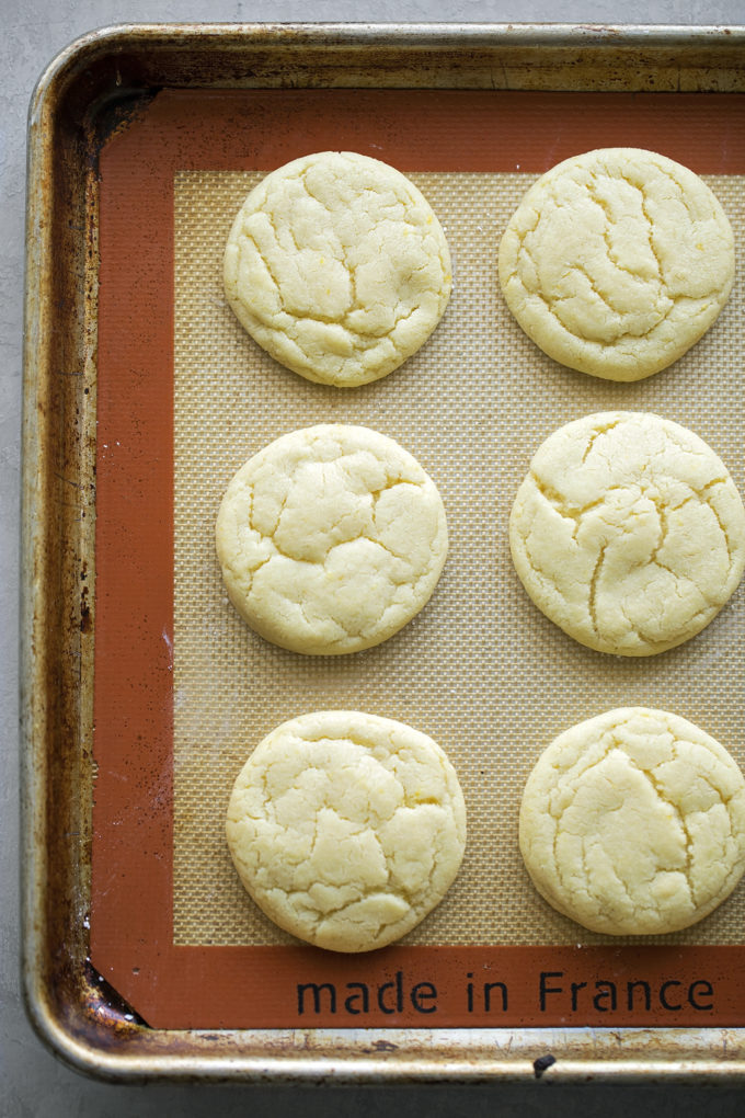 A baking sheet lined with a silicone baking mat is best for lemon sugar cookies.