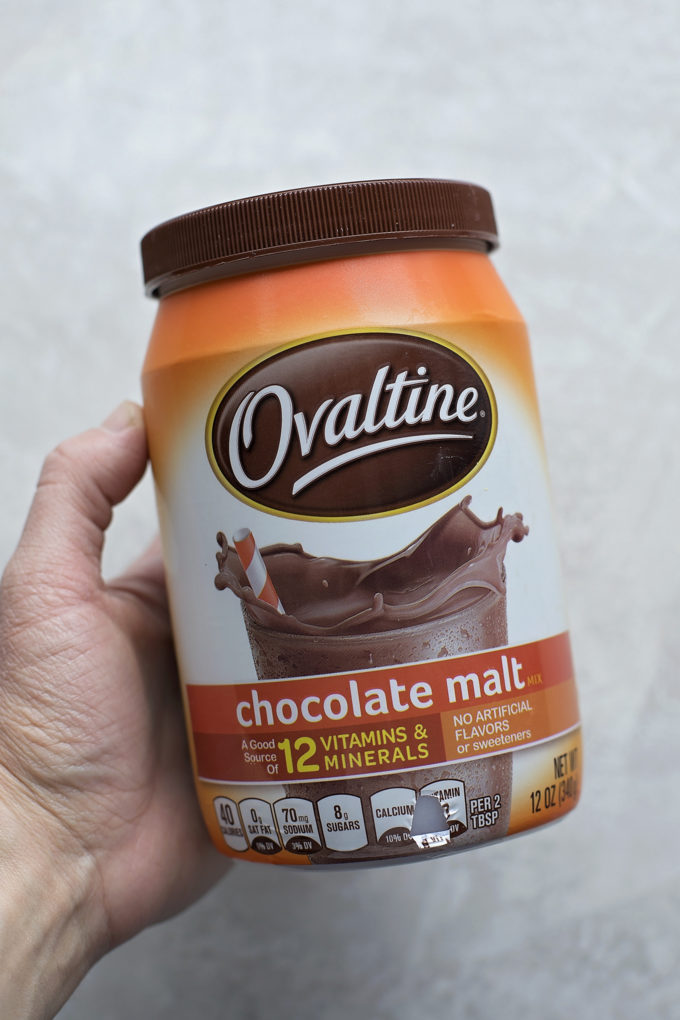 A bottle of chocolate malt powder used in the batter and frosting on malted chocolate nest cupcakes.