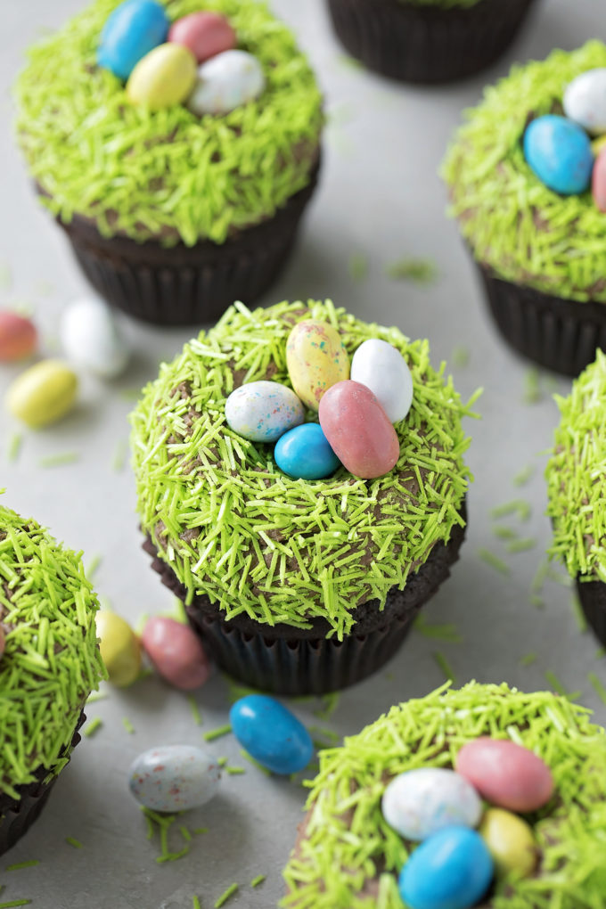 An arrangement of malted chocolate nest cupcakes topped with faux easter grass and eggs.